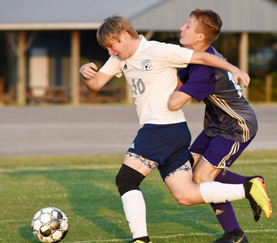 CHS freshman Andrew Butler tries to steal the ball.