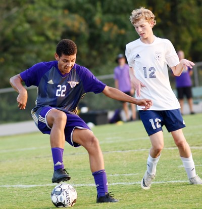 CHS sophomore Brice Spaw protects the ball.