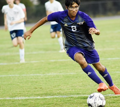 CHS junior Raj Patel dribbles down the field.