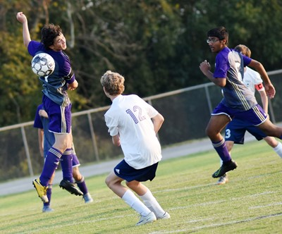 CHS sophomore Dakota Harris fights for the ball.