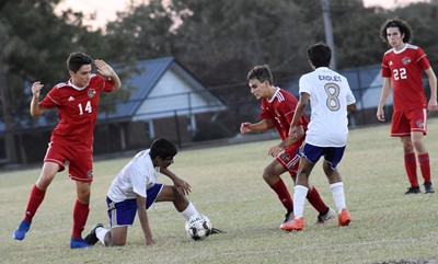 CHS sophomore Yash Patel, at left, and junior Raj Patel battle for the ball.