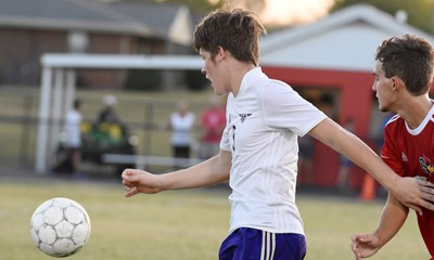 CHS sophomore Josh Lucas fights for the ball.