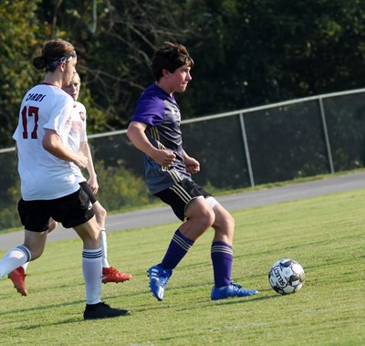 CHS sophomore Peyton Dabney kicks the ball.