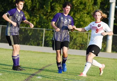 CHS junior Clark Kidwell, at left, and sophomore Peyton Dabney watch the ball.