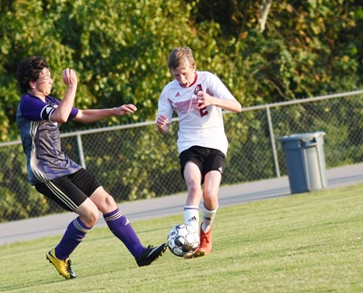 CHS sophomore Dakota Harris kicks the ball.