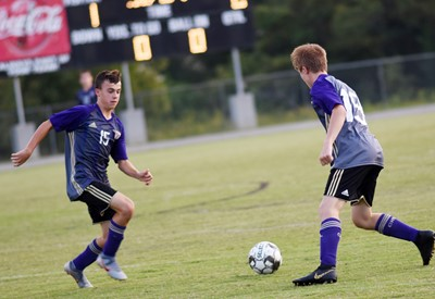CHS freshman Chase Hord kicks the ball to classmate Andrew Butler.