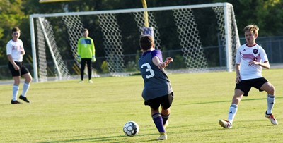 CHS sophomore Josh Lucas kicks the ball.