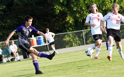 CHS junior Clark Kidwell kicks the ball.