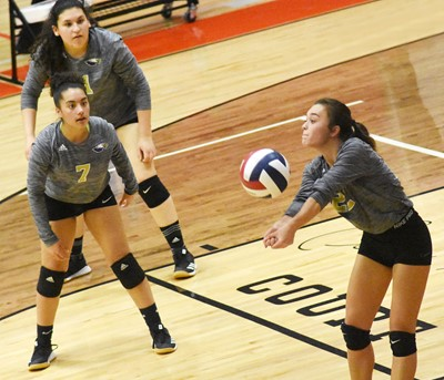 CHS junior Tayler Thompson hits the ball, as juniors Laci Hodgens, at left, and Anna Clara Moura watch.