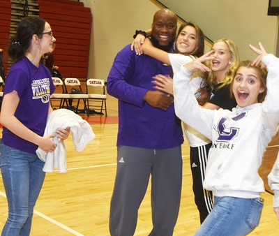 CHS volleyball head coach Anthony Epps celebrates the win with his players. From left are sophomores Sarah Adkins and Kaylyn Smith and Campbellsville Middle School eighth-graders Chloe Thompson and Braelyn Price.