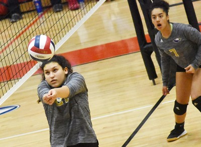 CHS junior Anna Clara Moura hits the ball over the net.
