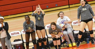 CHS volleyball players celebrate a point. From left are assistant Latavia Shively, sophomore Myricle Gholston, freshman BreAnna Humphress, junior Chloe Garrett, senior Shelby Smith and junior Anna Clara Moura.