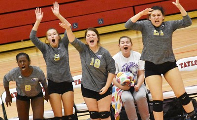 CHS volleyball players celebrate a point. From left are sophomore Myricle Gholston, freshman BreAnna Humphress, junior Chloe Garrett, senior Shelby Smith and junior Anna Clara Moura.
