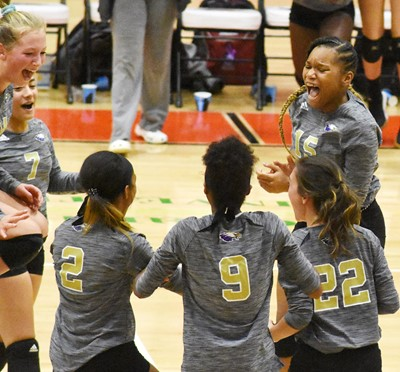CHS freshman Antaya Epps celebrates a point with her teammates.