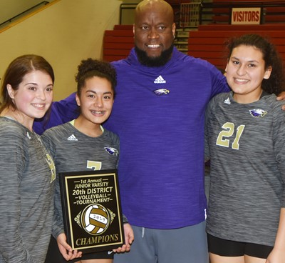 CHS juniors, from left, Chloe Garrett, Laci Hodgens and Anna Clara Moura smile for a photo with head coach Anthony Epps.