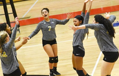 CHS junior Laci Hodgens, center, celebrates a point with her teammates.