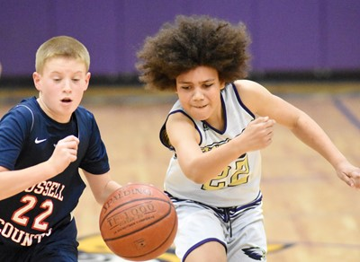 CMS sixth-grader Christian Hart fights for the ball.