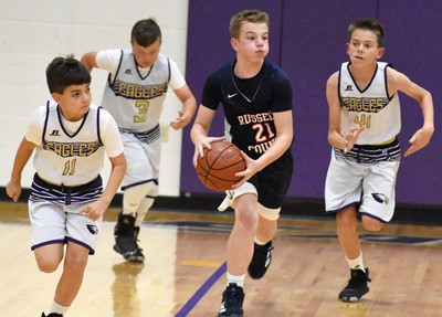 From left, CMS sixth-grader Easton Williams, Campbellsville Elementary School fifth-grader Cayton Lawhorn and sixth-grader Grayson Booe run down the court.