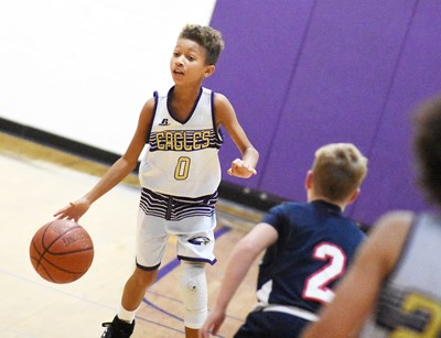 Campbellsville Elementary School fifth-grader Rajon Taylor sets up a play.