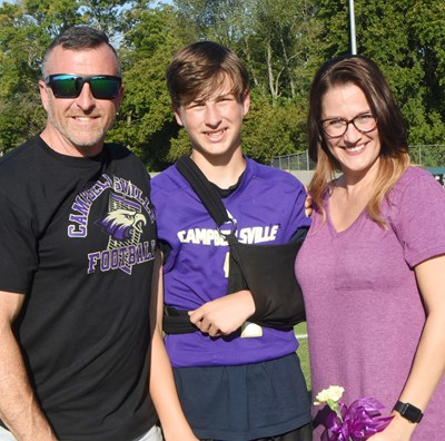 CMS eighth-grader Jaxon Sidebottom is honored, with his parents Spencer and Rebekah.