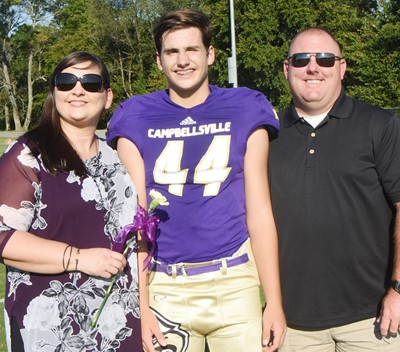 CMS eighth-grader Dalton Morris is honored, with his parents Jason and Shannon.