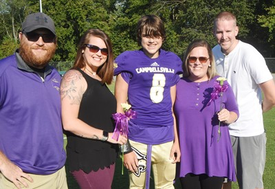 CMS eighth-grader Kaden Bloyd is honored, with his parents, from left, Isaiah Perkins, Brittany Mattingly, Cecile Wright and Kyle Bloyd.