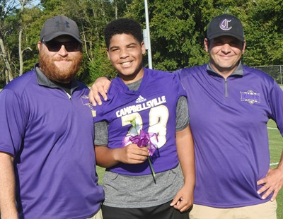 CMS eighth-grader Devin Kinser is honored, with assistant coach Isaiah Perkins, at left, and head coach Tommy Allen.