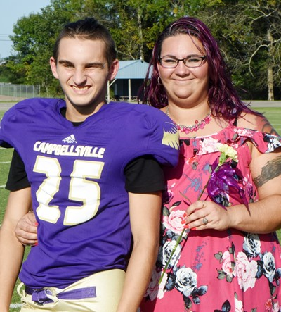 CMS eighth-grader Jordan Gabehart is honored, with his mother Amanda.