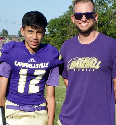 CMS eighth-grader Nathan Contreras is honored, with Principal Zach Lewis.