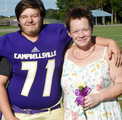 CMS eighth-grader Elijah Sears-Goin is honored, with his mother Jennifer.