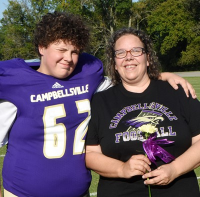 CMS eighth-grader Daniel Caton is honored, with his mother Tina Dishman.