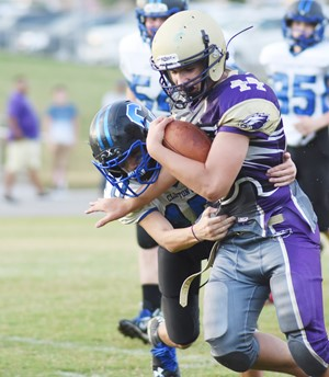 CMS eighth-grader Dalton Morris runs the ball.