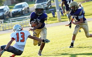 CMS eighth-grader Nasir Johnson runs the ball.
