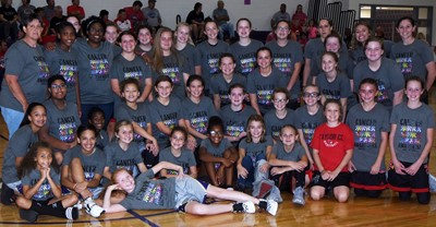 CMS girls' basketball players smile for a photo with Taylor County Middle School players.