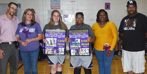 CMS eighth-graders Layla Steen, center, at left, and KyAshia Mitchell, center, at right, are honored for their dedication to the Lady Eagles basketball team. They are pictured with Steen's parents, Sarah Fraser and Jacob Hulin, and Mitchell's parents, April Mitchell and Tyrell Embry.