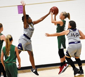 CMS seventh-grader Ta'Zaria Owens jumps to block a shot.