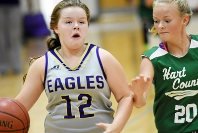CMS seventh-grader Miley Hash goes to the basket.