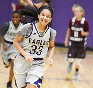 CMS sixth-grader Aleecia Knezevic smiles as her team wins the game.