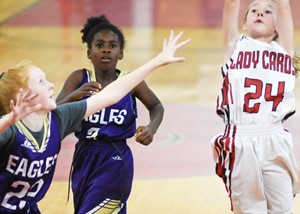 CMS sixth-grader Nora Harris, at left, and Campbellsville Elementary School fourth-grader Destini Gholston watch a shot.