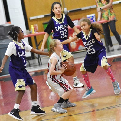 From left, Campbellsville Elementary School fourth-grader Willow Griffin, CMS sixth-grader Aleecia Knezevic and fourth-grader Londyn Smith play defense.