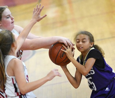 Campbellsville Elementary School fourth-grader Londyn Smith battles for the ball.