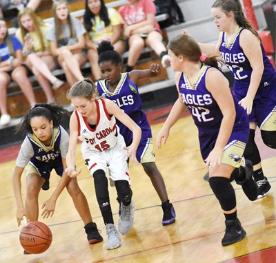 From left, CMS sixth-grader Alyssa Knezevic, Campbellsville Elementary School fourth-grader Destini Gholston and seventh-graders Keeley Dicken and Miley Hash run to the ball.
