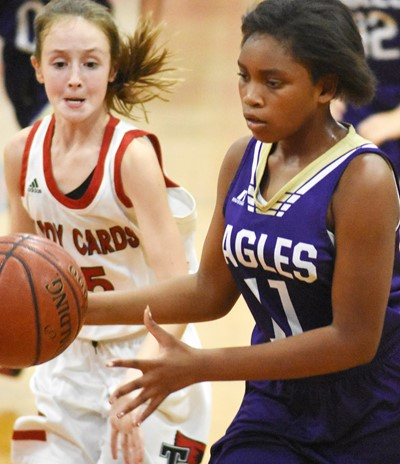 CMS seventh-grader Ta'Zaria Owens dribbles to the basket.