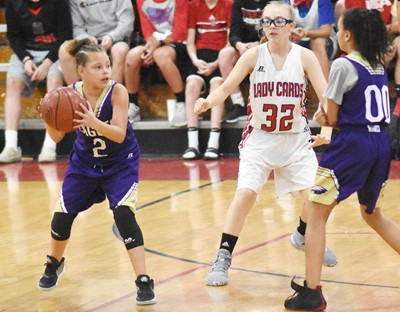 CMS sixth-grader Alexis Graves looks to pass.
