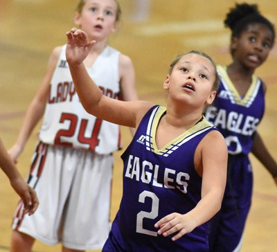 CMS sixth-grader Alexis Graves looks for a rebound.