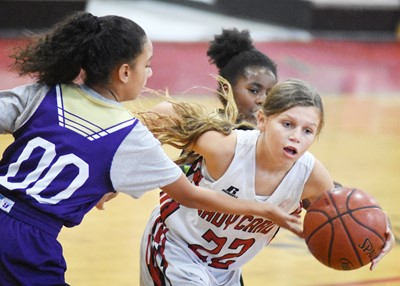 CMS sixth-grader Alyssa Knezevic fights for the ball.