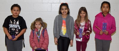From left are third-grader Marion Mann, kindergartener Maci Boyd, fourth-grader Sophia Santos, second-grader Gracie Gebler and fifth-grader Sunny Zhao. Absent from the photo is first-grader Kaylee Franklin.