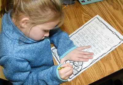 CES second-grader Riley Bright writes her thankful letter.