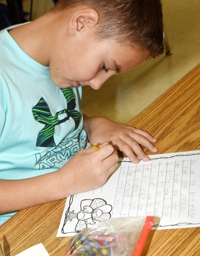 CES second-grader Braxton Rhodes writes his thankful letter.