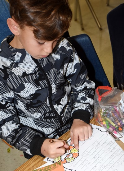 CES second-grader Phoenix Lawler writes his thankful letter.